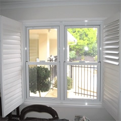 A white double hung aluminium window system in Canberra